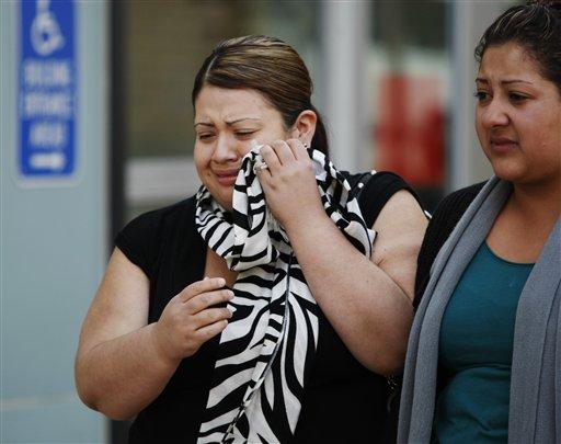 Two women who were identified as related to rape suspect Elvis Josue Torrentes, leave a Richmond, Calif. courthouse on Thursday, Nov. 5, 2009. (AP Photo/Paul Sakuma)