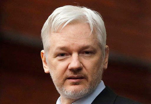 WikiLeaks founder Julian Assange stands on the balcony of the Ecuadorean Embassy in London.