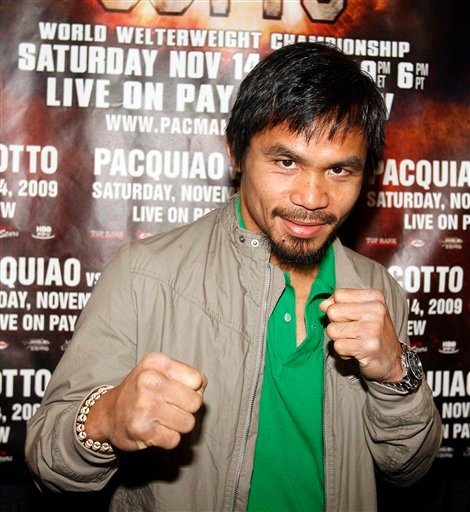 Manny Pacquiao, of the Philippines, arrives at the MGM Grand Hotel & Casino Tuesday, Nov. 10, 2009 in Las Vegas. Pacquiao will face Miguel Cotto, of Puerto Rico. (AP Photo/Isaac Brekken)