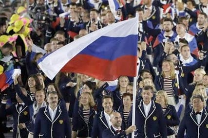 Sergei Tetiukhin carries the flag of Russia during the opening ceremony for the 2016 Summer Olympics in Rio de Janeiro, Brazil, Friday, Aug. 5, 2016.