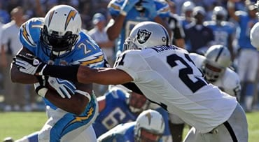 San Diego Chargers running back LaDainian Tomlinson, left, breaks free from Oakland Raiders' Nnamdi Asomugha, right, on a 10-yard touchdown run during the second quarter of a NFL football game Sunday, Nov. 1, 2009 in San Diego. The Chargers won the game 2