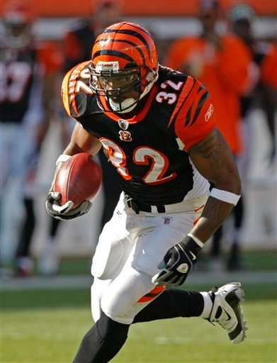 FILE - In this Nov. 8, 2009, file photo, Cincinnati Bengals running back Cedric Benson runs against the Baltimore Ravens during the first half of an NFL football game in Cincinnati. (AP Photo/Ed Reinke, File)