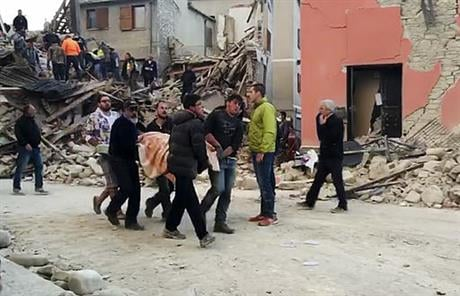 This still image taken from video shows rescuers recover a victim from a crumbled building in Amatrice, central Italy, where a 6.1 earthquake struck just after 3:30 a.m., Wednesday, Aug. 24, 2016.