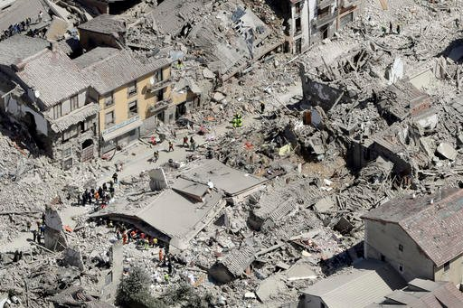 Rescuers search amid rubble following an earthquake in Amatrice Italy, Wednesday, Aug. 24, 2016.