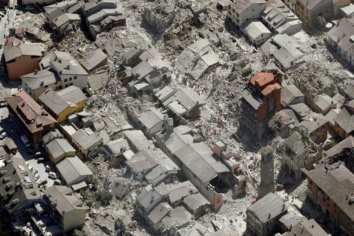 Aerial view of Amatrice in central Italy, Wednesday, Aug. 24, 2016, as it appears after a magnitude 6 quake struck at 3:36 a.m. (0136 GMT) and was felt across a broad swath of central Italy, including Rome where residents of the capital felt a long swayin