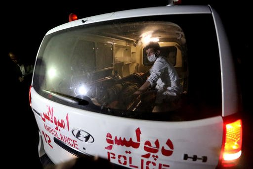 A man wounded is assisted in an ambulance after a complex Taliban attack on the campus of the American University in the Afghan capital Kabul on Wednesday, Aug. 24, 2016. University President Mark English told The Associated Press that security forces had