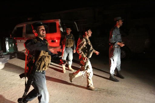 Afghan security forces rush to respond to a complex Taliban attack on the campus of the American University in the Afghan capital Kabul on Wednesday, Aug. 24, 2016. University President Mark English told The Associated Press that security forces had arriv