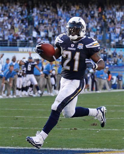 San Diego Chargers running back LaDainian Tomlinson hits the endzone while scoring against the Philadelphia Eagles defense on a 20-yard run during the third quarter of a NFL football game Sunday, Nov. 15, 2009 in San Diego. (AP Photo/Denis Poroy)