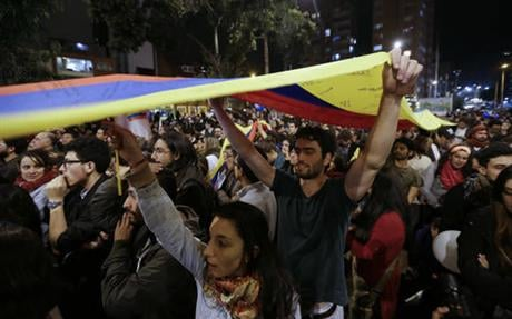 The government's accord with the Revolutionary Armed Forces of Colombia must still be ratified by voters in a plebiscite in order to take effect. (AP Photo/Fernando Vergara)