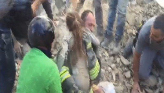 A 10-year-old girl is rescued from the debris of a collapsed building in Pescara del Tronto.