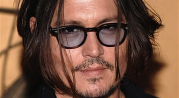 "FILE - In this Nov. 17, 2009 file photo, actor Johnny Depp attends The Museum of Modern Art's film benefit tribute to Tim Burton in New York. Depp was named People magazine's ""Sexiest Man Alive"" on Wednesday, Nov. 18, 2009. (AP Photo/Evan Agostini, File)"