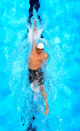 In this Sunday, June 26, 2016, file photo, Ryan Lochte swims during a preliminary heat in the Men's 400-meter individual medley at the U.S. Olympic swimming trials, in Omaha, Neb. Speedo announced Monday, Aug. 22, 2016, that they are dropping their sponso