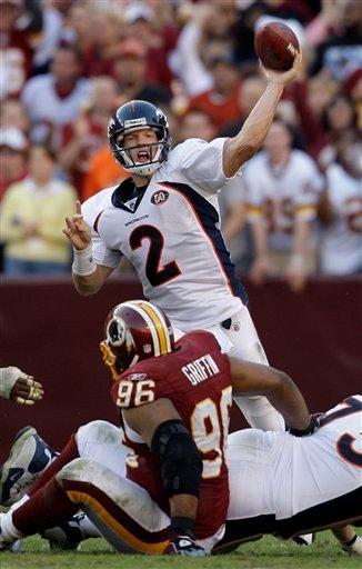 Denver Broncos quarterback Chris Simms (2) throws a pass while being pressured by Washington Redskins Cornelius Griffin (96) during the second half of an NFL football game, Sunday, Nov. 15, 2009, in Landover, Md. Washington won 27-17. (AP Photo/Rob Carr)