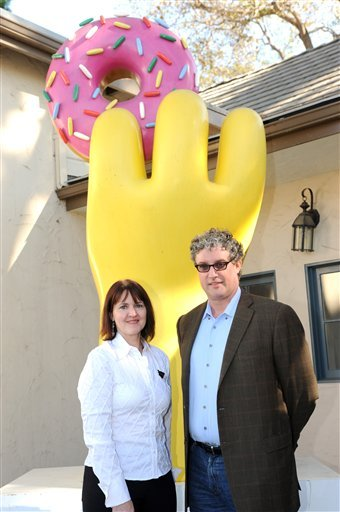 "In this publicity image released by Fox, Grand-Prize Winner of ""The Simpsons Character Contest,"" Peggy Black, of Orange, Conn., and ""The Simpsons"" executive producer Al Jean,pose for a photo on Monday, Nov. 16, 2009, in Los Angeles. The long-running anima"
