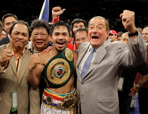 FILE - In this May, 2, 2009, file photo, boxer Manny Pacquiao, of the Philippines, celebrates with trainers and promoters, including, Bob Arum, right. (AP Photo/ Jae C. Hong, File)