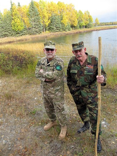 In this photo taken Tuesday Sept. 29, 2009, Ray Southwell, left, and Norm Olson, members of the Alaska Citizens Militia, stand by the woods near their home in Nikiski, Alaska. (AP Photo/Rachel D'Oro)
