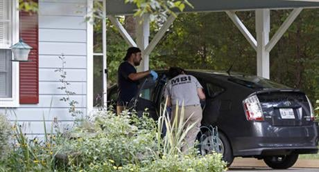 The clinic office manager and a Durant police officer discovered their bodies inside the house after both nuns did not report for work. Authorities said their were signs of a break-in and their vehicle was missing. (AP Photo/Rogelio V. Solis)