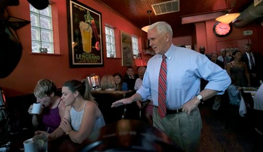 Republican vice presidential candidate, Indiana Gov. Mike Pence, right, surprises patrons at Millie's Diner in Richmond, Va. Saturday, Aug. 27, 2016, during an impromptu visit by the candidate to the popular restaurant. (Bob Brown/Richmond Times-Dispatch