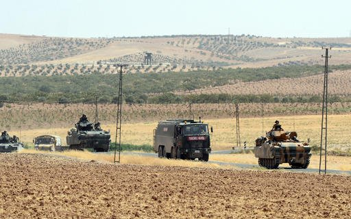 Turkish troops return from the Syrian border, in Karkamis, Turkey, Saturday, Aug. 27, 2016. Turkey on Wednesday sent tanks across the border to help Syrian rebels retake the key Islamic State-held town of Jarablus and to contain the expansion of Syria's K