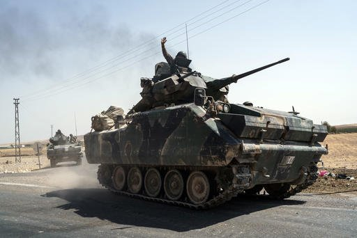 Turkish troops head to the Syrian border, in Karkamis, Turkey, Saturday, Aug. 27, 2016. Turkey on Wednesday sent tanks across the border to help Syrian rebels retake the key Islamic State-held town of Jarablus and to contain the expansion of Syria's Kurds