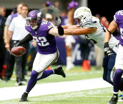 Minnesota Vikings free safety Harrison Smith (22) runs from San Diego Chargers tight end Hunter Henry, right, after intercepting a pass during the first half of an NFL preseason football game Sunday, Aug. 28, 2016, in Minneapolis. (AP Photo/Jim Mone)