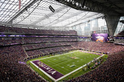 Fans watch the second half of an NFL preseason football game between the Minnesota Vikings and the San Diego Chargers in U.S. Bank Stadium, Sunday, Aug. 28, 2016, in Minneapolis. (AP Photo/Andy Clayton-King)