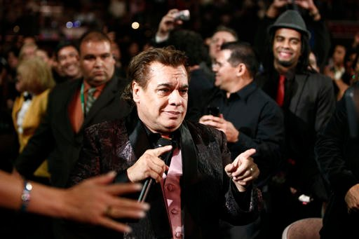 In this Nov. 5, 2009, file photo, Mexican singer Juan Gabriel performs at the 10th Annual Latin Grammy Awards on Thursday in Las Vegas. Representatives of Juan Gabriel have reported Sunday, Aug. 28, 2016, that he has died. Gabriel was Mexico's leading sin