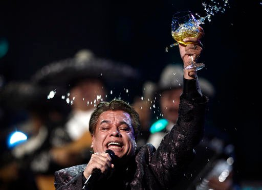 In this Nov. 5, 2009, file photo, Juan Gabriel performs at the 10th Annual Latin Grammy Awards in Las Vegas. Representatives of Juan Gabriel have reported Sunday, Aug. 28, 2016, that he has died. (AP Photo/Matt Sayles, File)