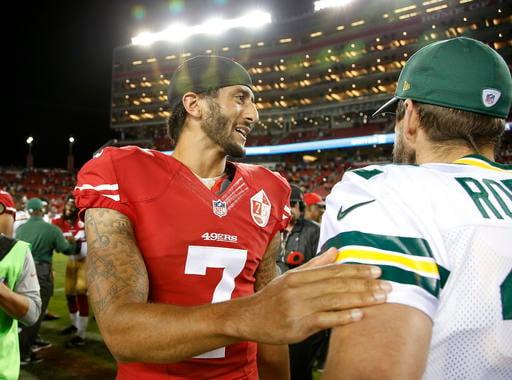 San Francisco 49ers quarterback Colin Kaepernick, left, greets Green Bay Packers quarterback Aaron Rodgers at the end of an NFL preseason football game Friday, Aug. 26, 2016, in Santa Clara, Calif. Green Bay won 21-10. (AP Photo/Tony Avelar)