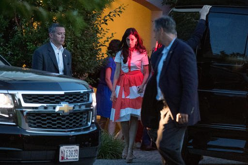 In this photo taken Aug. 28, 2016, Democratic presidential candidate Hillary Clinton's senior aid Huma Abedin, center, departs a fundraiser at a private home in Southampton, N.Y. Abedin says she is separating from husband Anthony Weiner after another sext