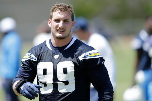 In this May 13, 2016, file photo, San Diego Chargers rookie defensive end Joey Bosa trains during an NFL football rookie training camp in San Diego.
