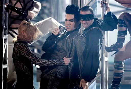 FILE - In this Sunday, Nov. 22, 2009 file photo, Adam Lambert, center, performs during the closing act of the 37th Annual American Music Awards in Los Angeles. (AP Photo/Matt Sayles, File)