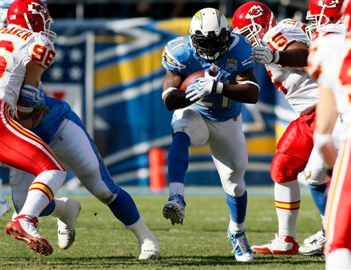 San Diego Chargers running back LaDainian Tomlinson (21) heads through a hole for a six-yard gain during the first quarter of an NFL football game against the Kansas City Chiefs, Sunday, Nov. 29, 2009, in San Diego. (AP Photo/Denis Poroy)