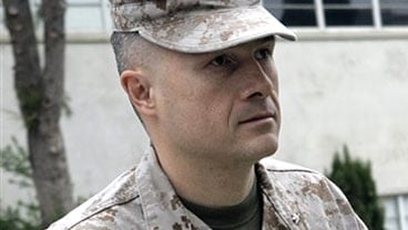 FILE - This May 30, 2007 file photo shows U.S. Marine Lt. Col. Jeffrey R. Chessani arriving at a preliminary hearing where he is charged with violation of a lawful order and dereliction of duty at Camp Pendleton, Calif.  (AP Photo/Lenny Ignelzi, File)