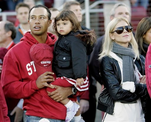 FILE - This is a Nov. 21, 2009, file photo showing Tiger Woods with his daughter, Sam, and wife, Elin, before the start of an NCAA college football game between Stanford and California, in Stanford, Calif.