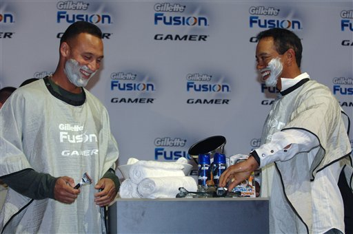 FILE - In this Feb. 3, 2009, file photo provided by Gillette, Gillette Champions New York Yankees' Derek Jeter, left, and golfer Tiger Woods help launch the Gillette Fusion Power Gamer razor during the Gillette-EA SPORTS Champions of Gaming Finals.