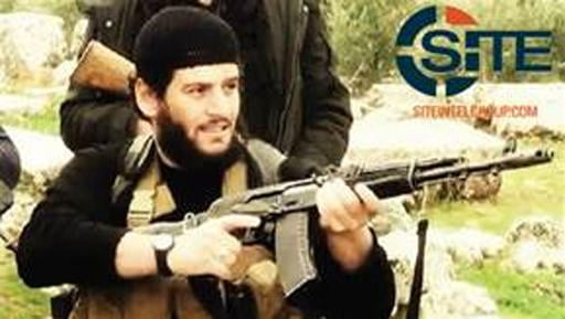 This undated militant image provided by SITE Intel Group shows Abu Mohammed al-Adnani, the Islamic State militant group's spokesman.