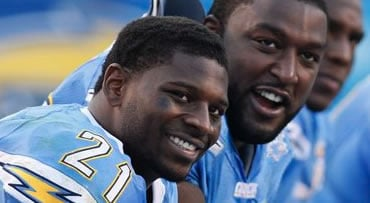 San Diego Chargers LaDainian Tomlinson, left, and Marcus McNeill laugh on the bench during the fourth quarter of an NFL football game against the Kansas City Chiefs, Sunday Nov. 29, 2009, in San Diego. The Chargers won 43-14. (AP Photo/Denis Poroy)