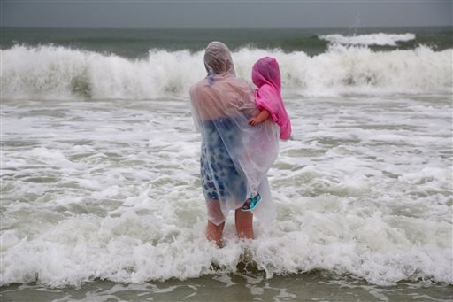 Lisa Bolton holds her three-year-old daughter Lois Bolton, both of Manchester, England, during a visit on Wednesday, Aug. 31, 2016, to Clearwater Beach, Fla. The National Hurricane Center in Miami says Tropical Storm Hermine is gaining strength as it rumb