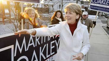 Massachusetts Attorney General Martha Coakley greets supporters outside a polling place in Medford, Mass., Tuesday, Dec. 8, 2009. (AP Photo/Josh Reynolds)