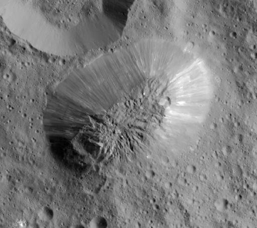 This image provided by NASA, shows an inactive volcano on the surface of Ceres, the largest object in the asteroid belt between Mars and Jupiter. Scientists said the volcano on the dwarf planet Ceres is about half as tall as Mount Everest. (NASA/JPL-Calte