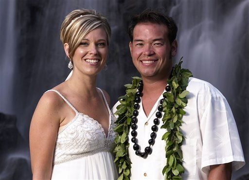 """FILE - This image released by TLC, shows Jon Gosselin, right, and his wife Kate Gosselin, from the TLC series """"Jon & Kate Plus 8,"""" in Hawaii. (AP Photo/TLC, Mark Arbeit)"""