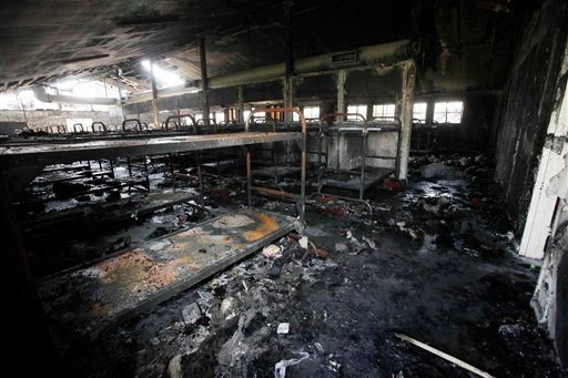FILE - In this Tuesday Aug. 11, 2009 file photo, dozens of burned-out bunks are seen in a dormitory damaged by fire, during a tour of the California Institution for Men in Chino, Calif. (AP Photo/Reed Saxon, File)