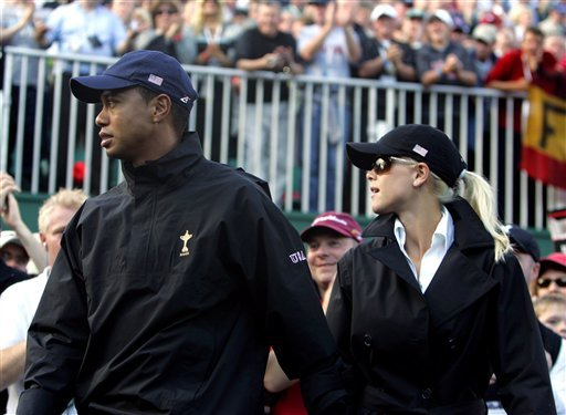 FILE - In this Sept. 24, 2006, file photo, Tiger Woods of the United States and his wife Elin walk away from the 16th green as the European players celebrate on the last day of the 2006 Ryder Cup at the K Club golf course, Straffan, Ireland.