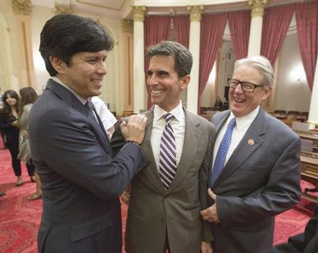 State Sen. Mark Leno, D-San Francisco, center, is congratulated by Senate President pro tempore Kevin de Leon, D-Los Angeles, left, and Sen. William Monning, D-Carmel, after the end of the two-year legislative session, Thursday, Sept. 1, 2016, in Sacramen