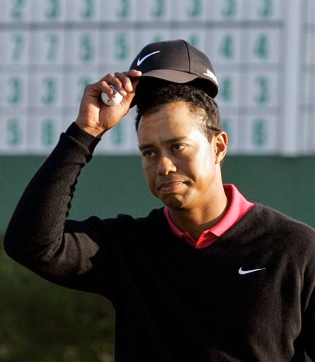 FILE - This is an April 8, 2007, file photo showing Tiger Woods tipping his cap on the 18th hole during the final round of the 2007 Masters golf tournament at the Augusta National Golf Club in Augusta, Ga. (AP Photo/Elise Amendola, File)