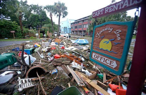 A street is blocked from debris washed up from the tidal surge of Hurricane Hermine Friday, Sept. 2, 2016.