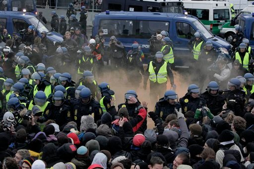 Danish riot police pushes back protestors during a demonstration outside the Bella Center, the venue of the U.N. Climate Conference, in Copenhagen Wednesday Dec. 16, 2009.