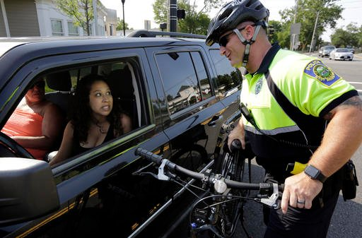 Police officer Matthew Monteiro speaks to a motorist about texting while driving.