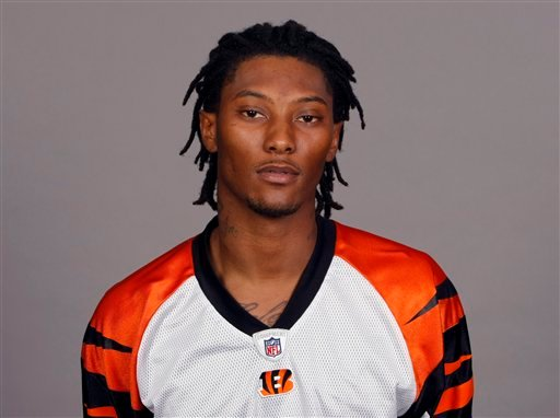 This is a 2009 file photo showing Cincinnati Bengals football player. Charlotte-Mecklenburg police say Henry has died Thursday Dec. 17, 2009.